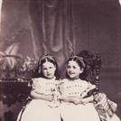 Two girls with dolls